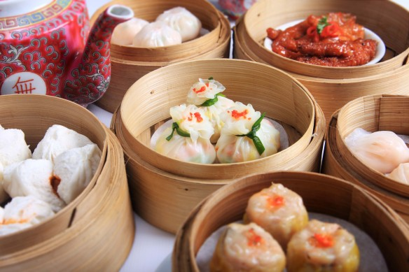 variety of dim sum in bamboo steam containers